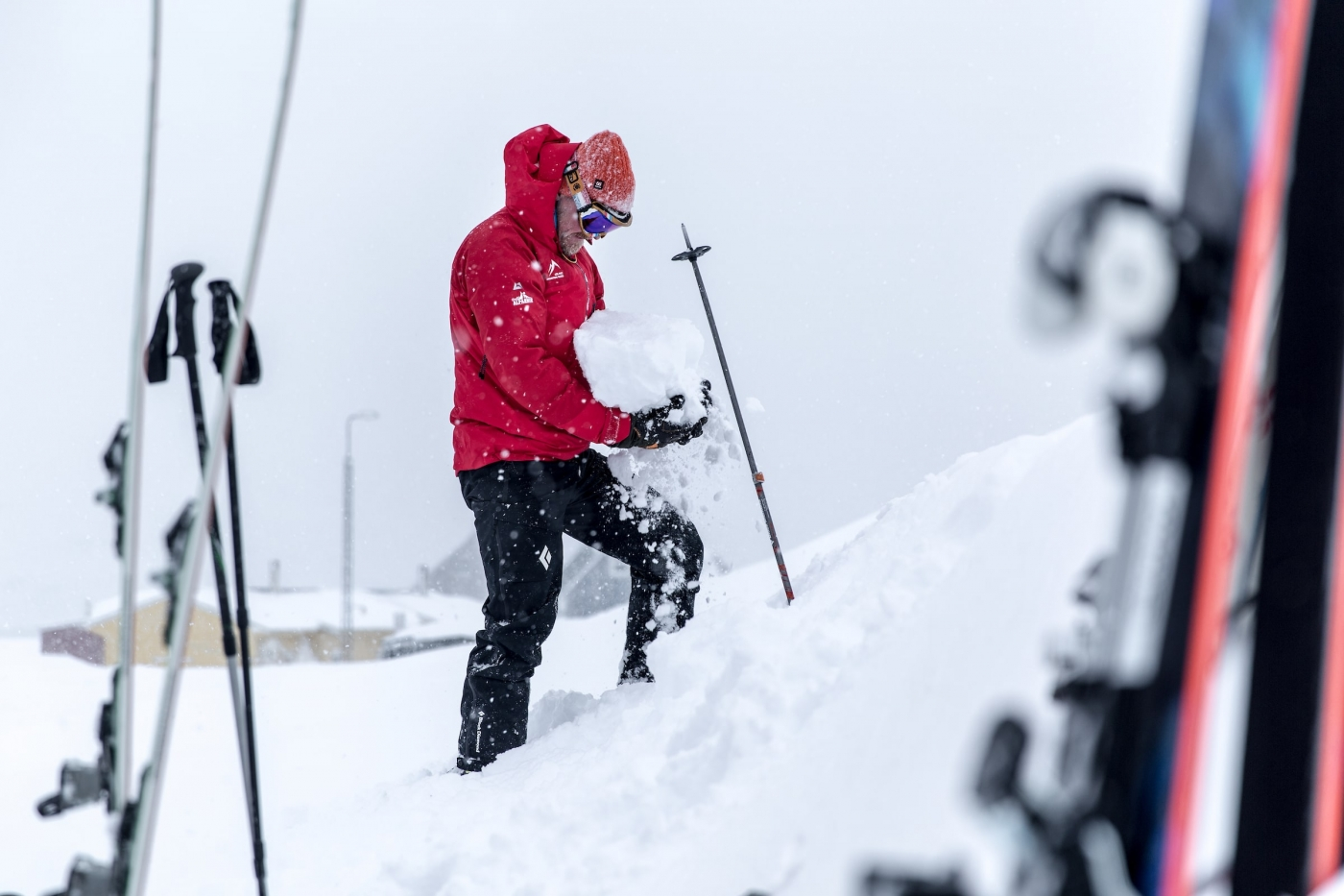 The ski touring guide checking snow conditions in Kuummiut in East Greenland. Photo by Mads Pihl - Visit Greenland