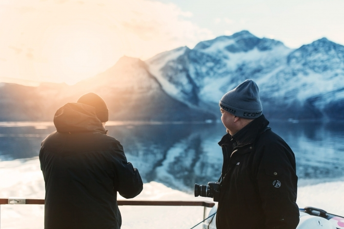 Two men enjoying the sunrise in the Icefjord in Nuuk in Greenland. Photo by Rebecca Gustafsson