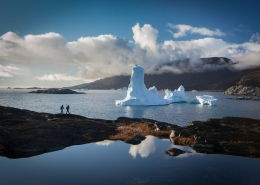 Two people trekking the Ilulissat icefjord. Photo by Paul Zizka, Visit Greenland