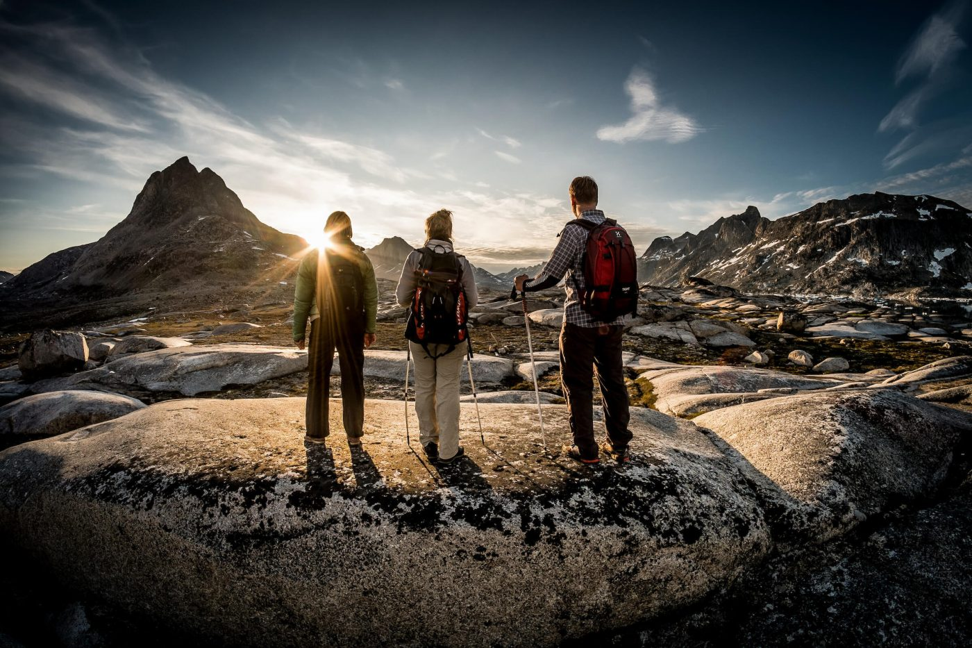 Three hikers in the setting sun near Qernertivartivit in East Greenland, by Mads Pihl