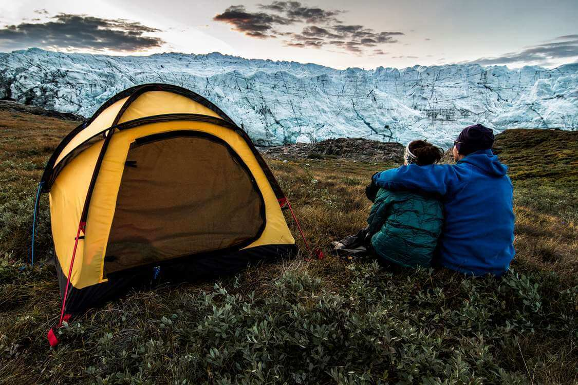 Hikers enjoying Russell Glacier near Kangerlussuaq in Greenland. Photo by Mads Pihl - Visit Greenland