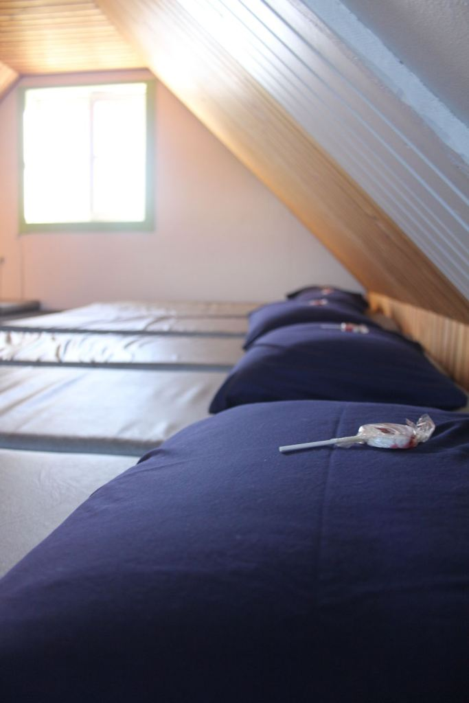Lollipop on pillows in dorm at Kulusuk Hostel in East Greenland. Photo by Icelandic Mountain Guides
