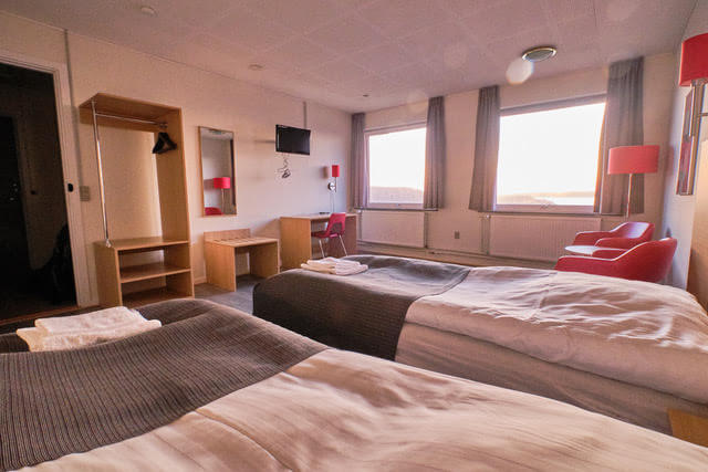 Double room with large storage and study area. Photo by Lisa Germany, Visit Greenland