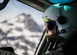 Helicopter pilot from Air Greenland on his way to top of Qingaaq mountain in Nuuk fjord. Photo by Filip Gielda