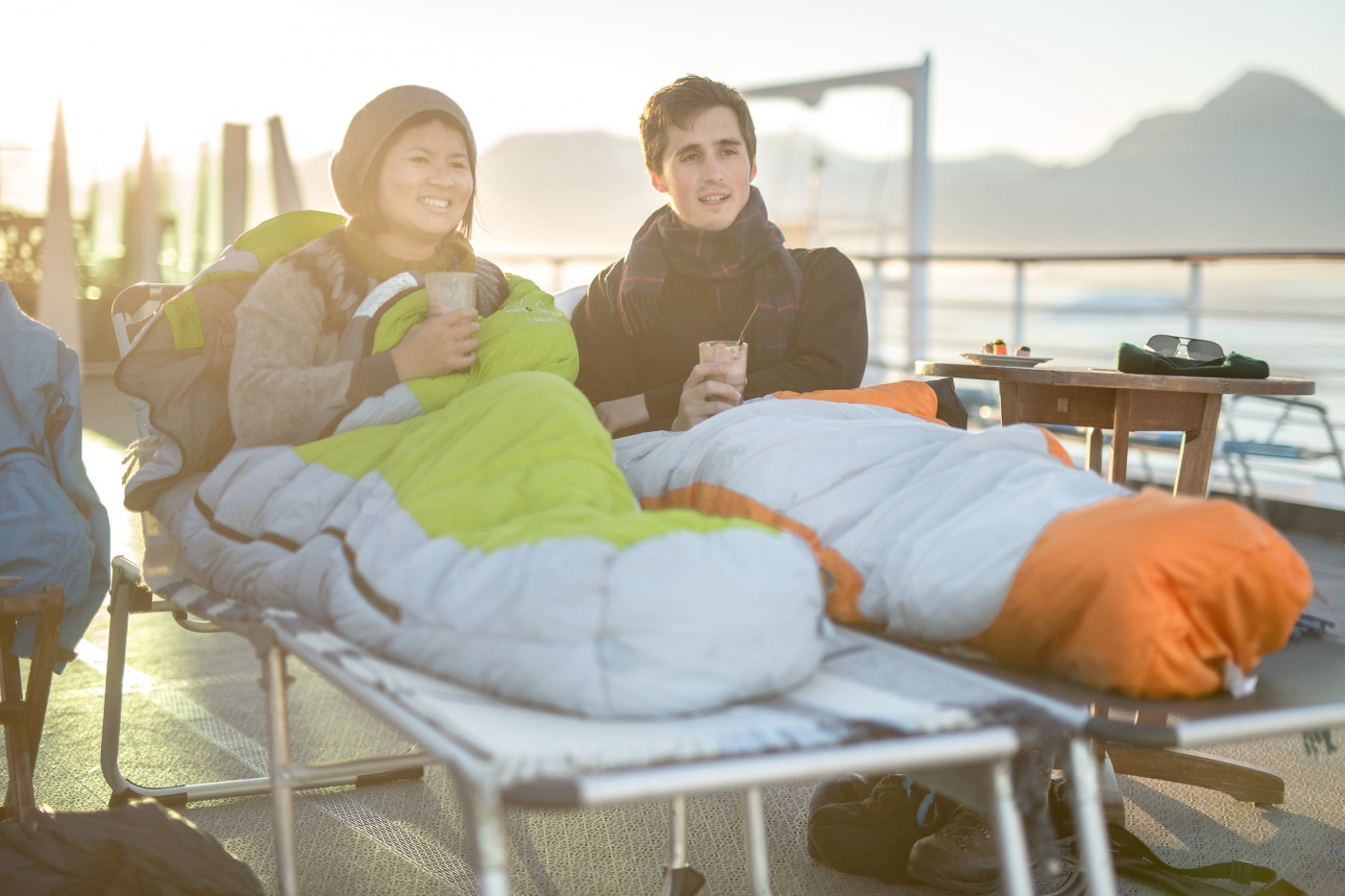 A young couple on a cruise in the midnight sun in Greenland. By Mads Pihl
