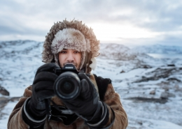 Canadian social media influencer Siya Zarrabi taking photos in seal skin clothes near Ilulissat in Greenland. Photo by Rebecca Gustafsson - Visit Greenland
