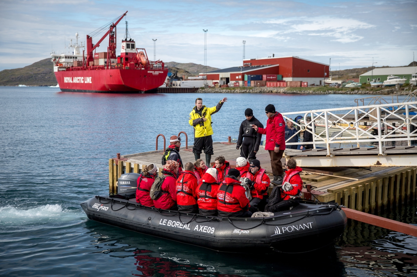 Cruise guests arriving by tenderboat in Narsaq in South Greenland.