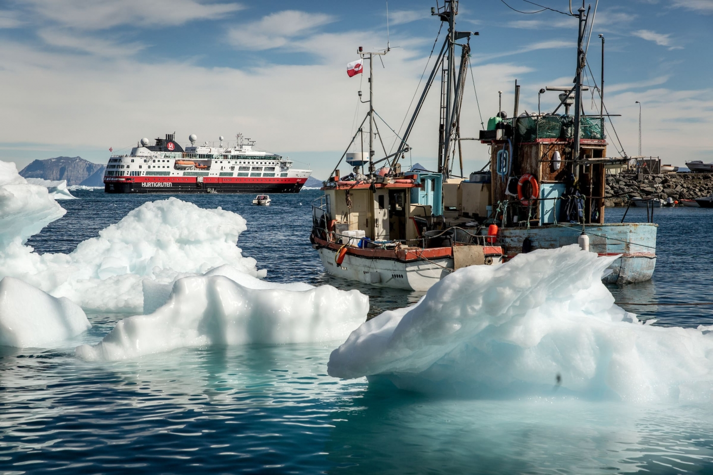 Fishing boats and MS Fram in Uummannaq in Greenland. By Mads Pihl