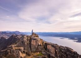 Hiker on top of Nasaasaaq - Arctic Circle Trail option. Photo by Lisa Germany