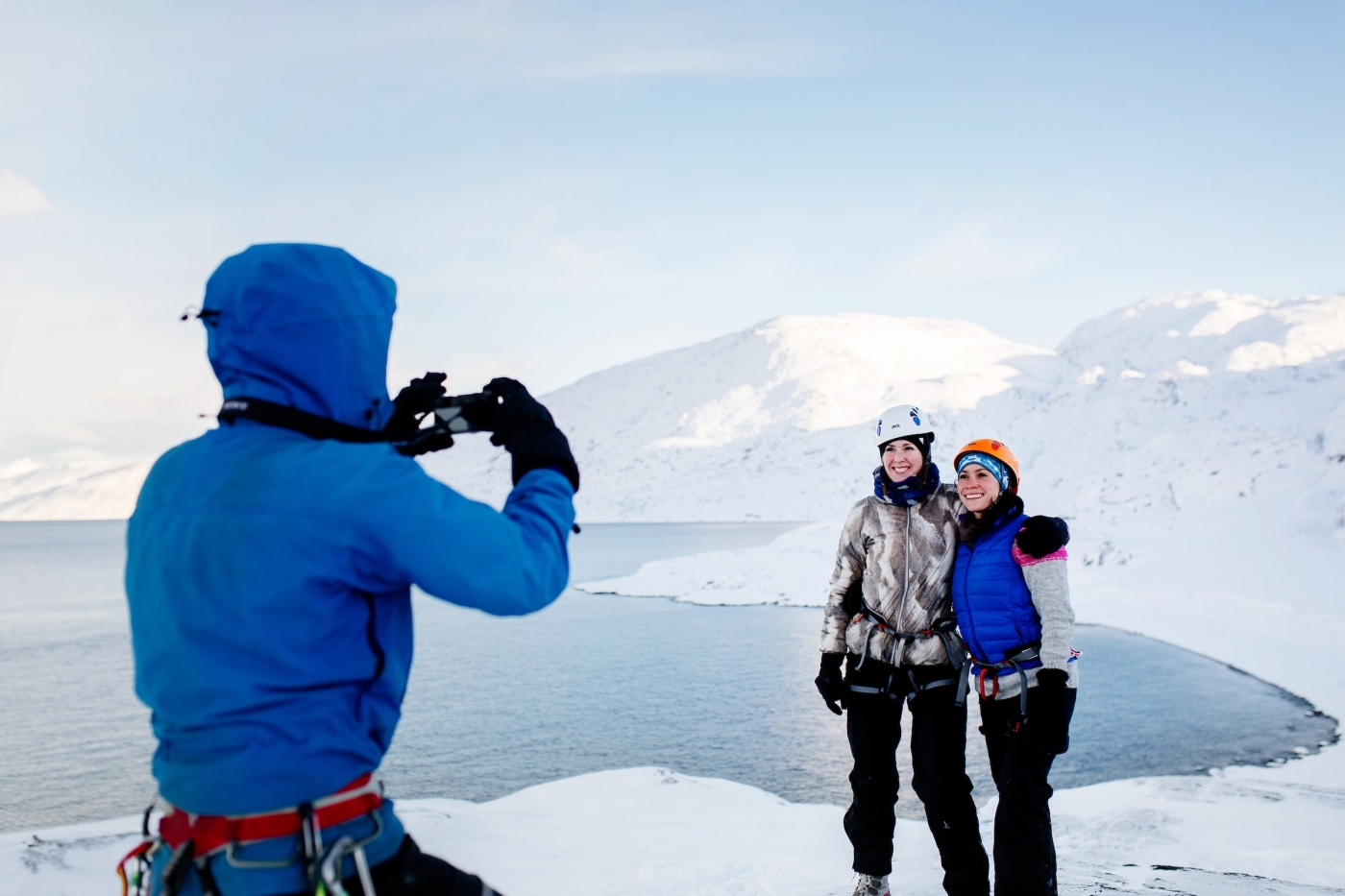 Mountain guide Marc Carreras taking photos of tourist on a winter hike in Nuuk in Greenland. By Rebecca Gustafsson