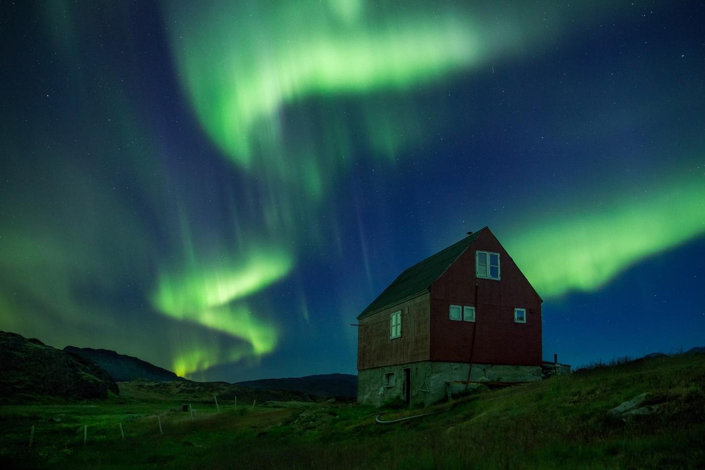 Northern lights over Sermilik Hostel at Tasiusaq sheep farm in South Greenland. By Mads Pihl