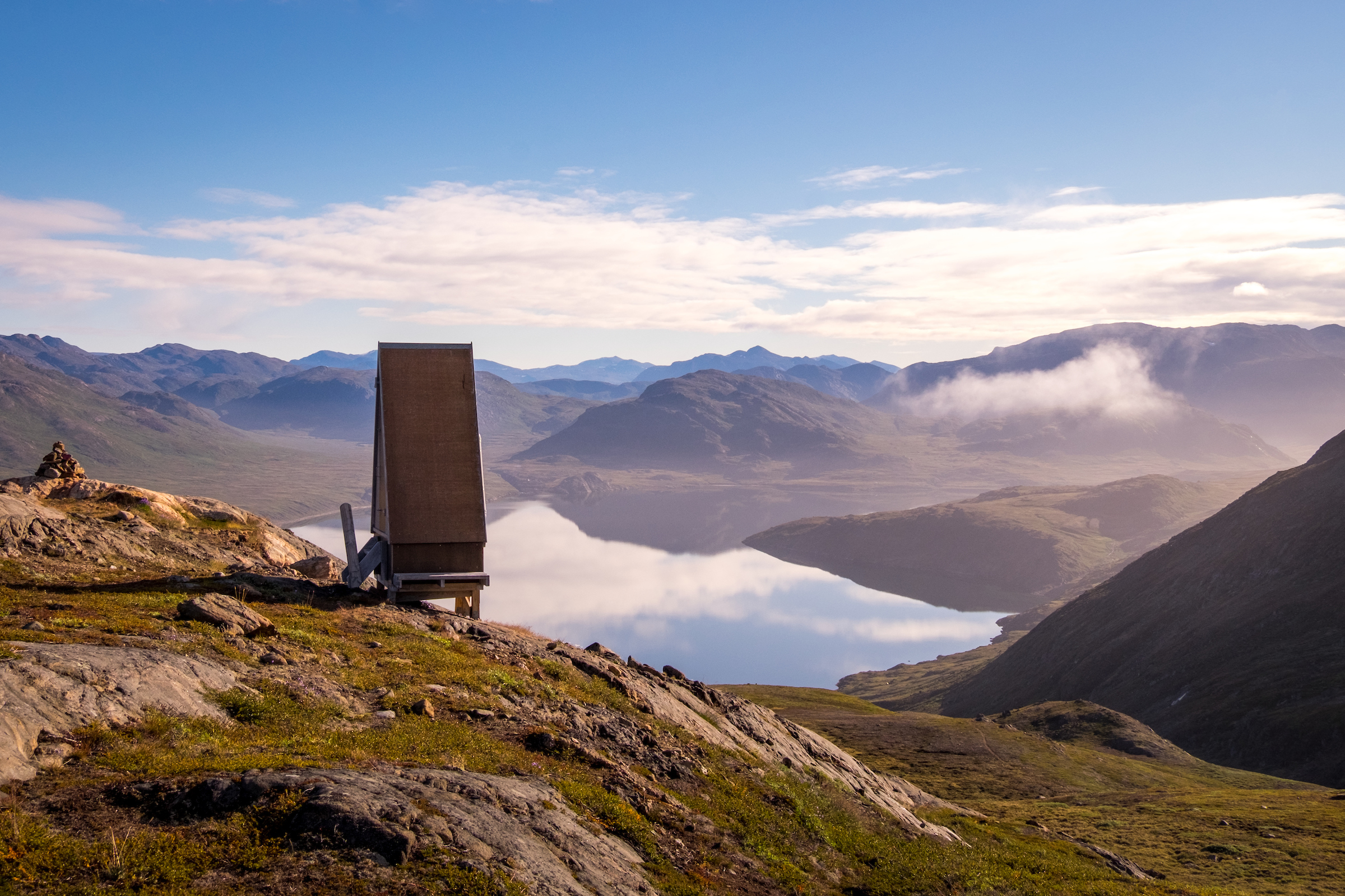 Pyramid shaped toilet overlooking Kangerluarsuk Tulleq fjord at the top of the pass - Day 8 of Arctic Circle Trail. By Lisa Germany