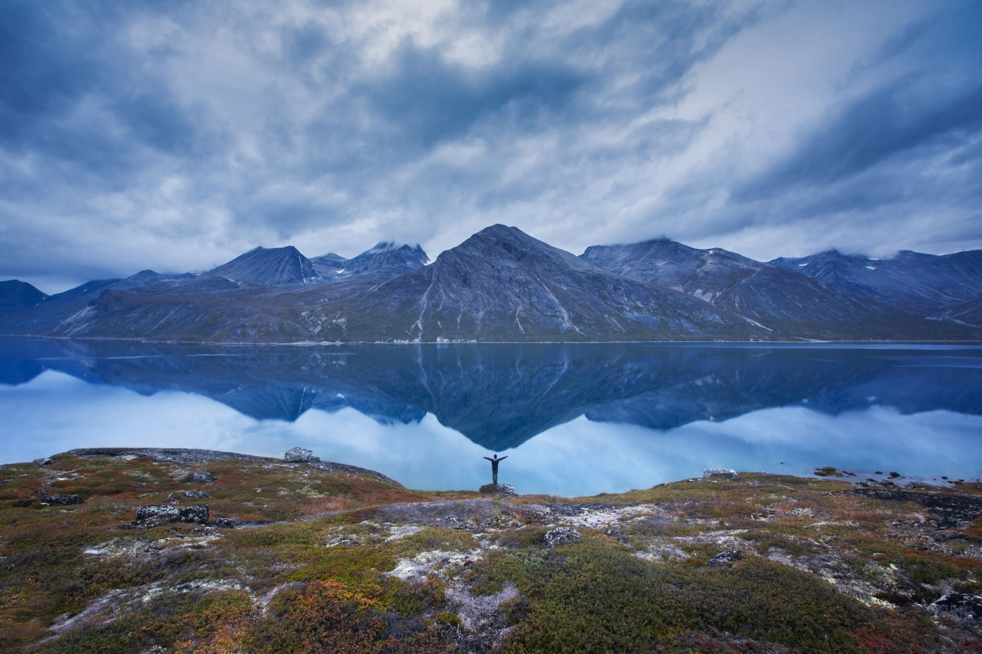 Solo hiker in South Greenland gives gratitude and a hug to Mother Earth for being so breathtaking. By Paul Zizka