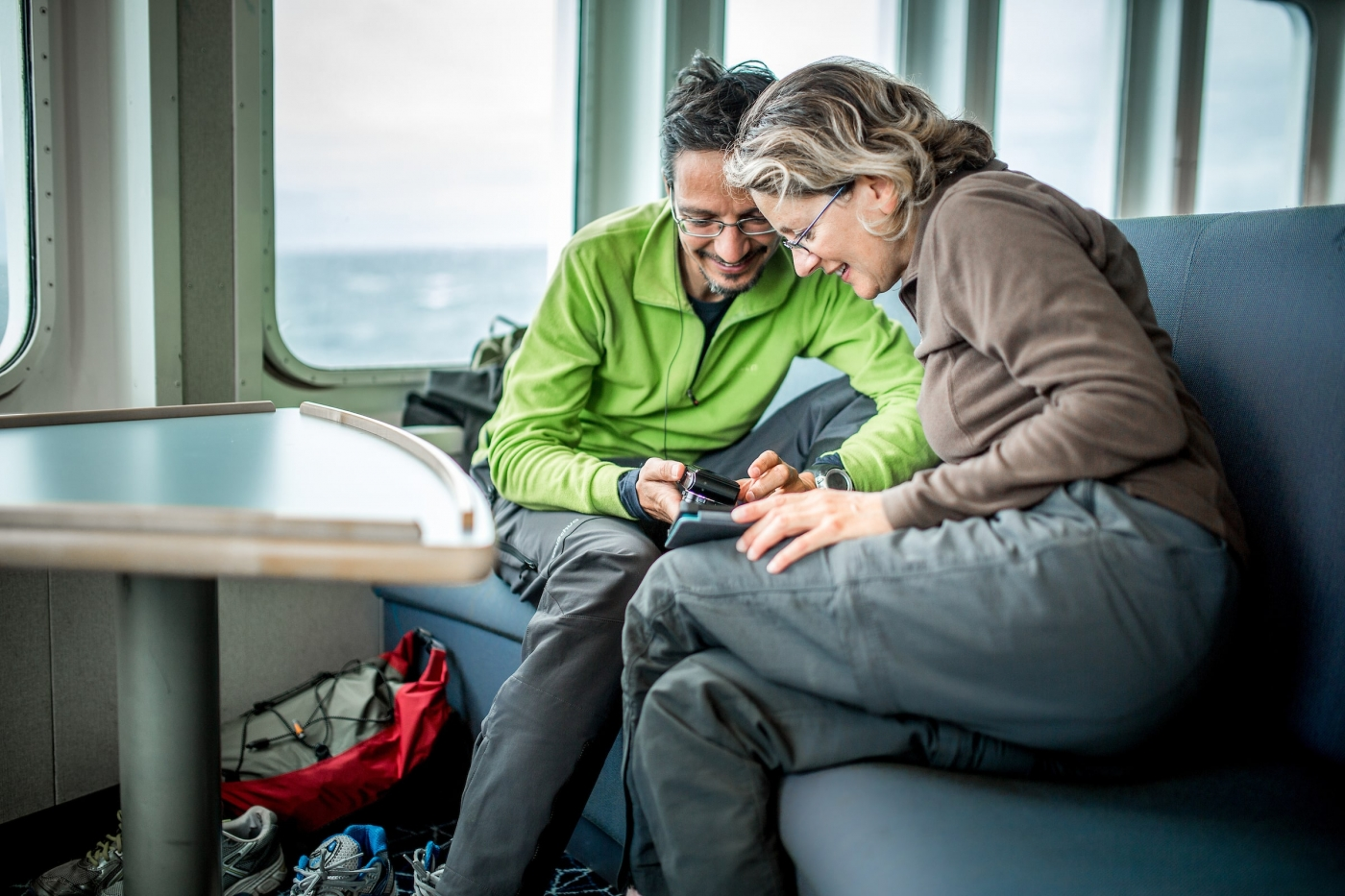 Two guests in the lounge on Sarfaq Ittuk in Greenland. Photo by Mads Pihl - Visit Greenland