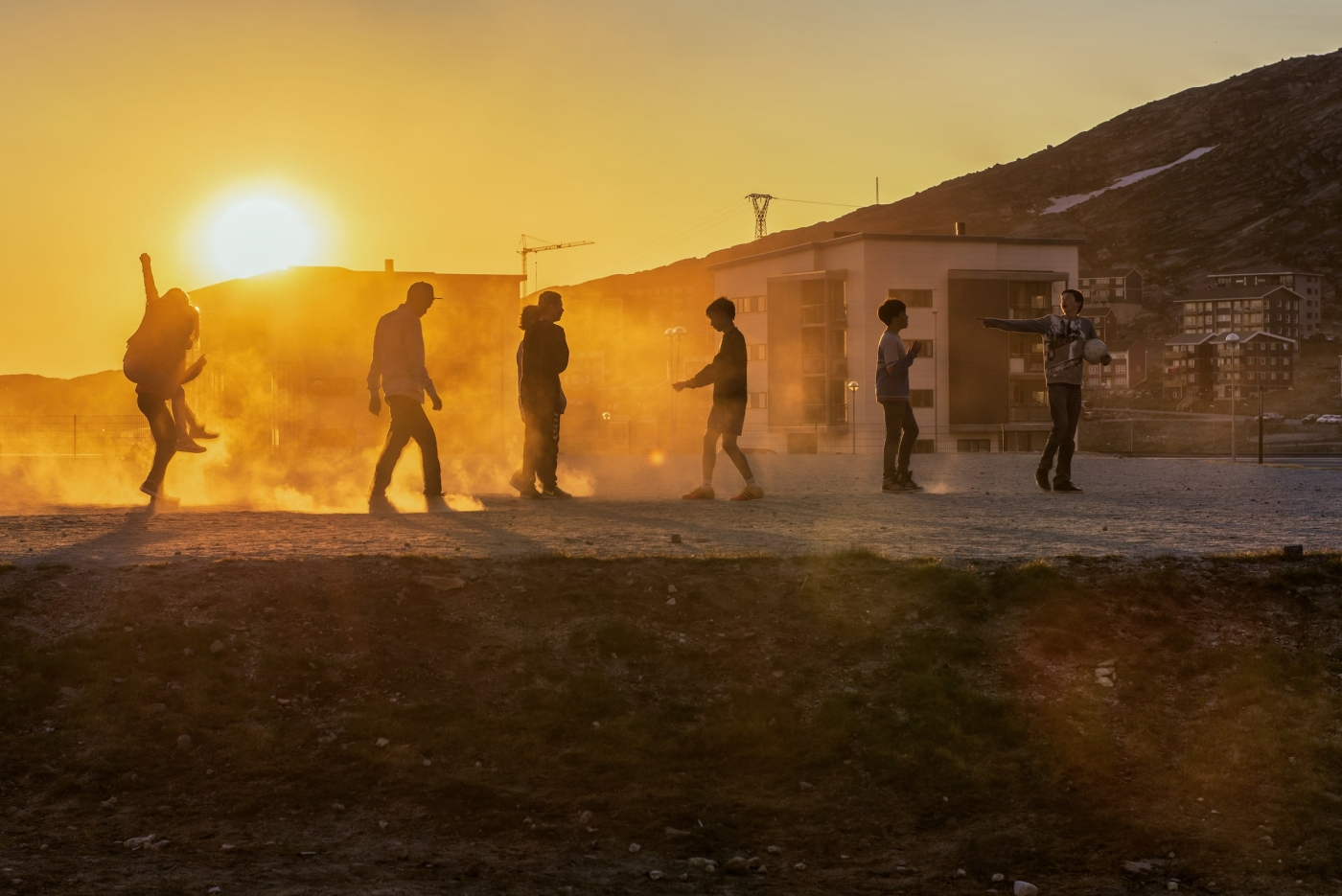 Young kids playing soccer in Qingorput in the sunset in Nuuk in Greenland. Photo by Carlo Lukassen - Visit Greenland