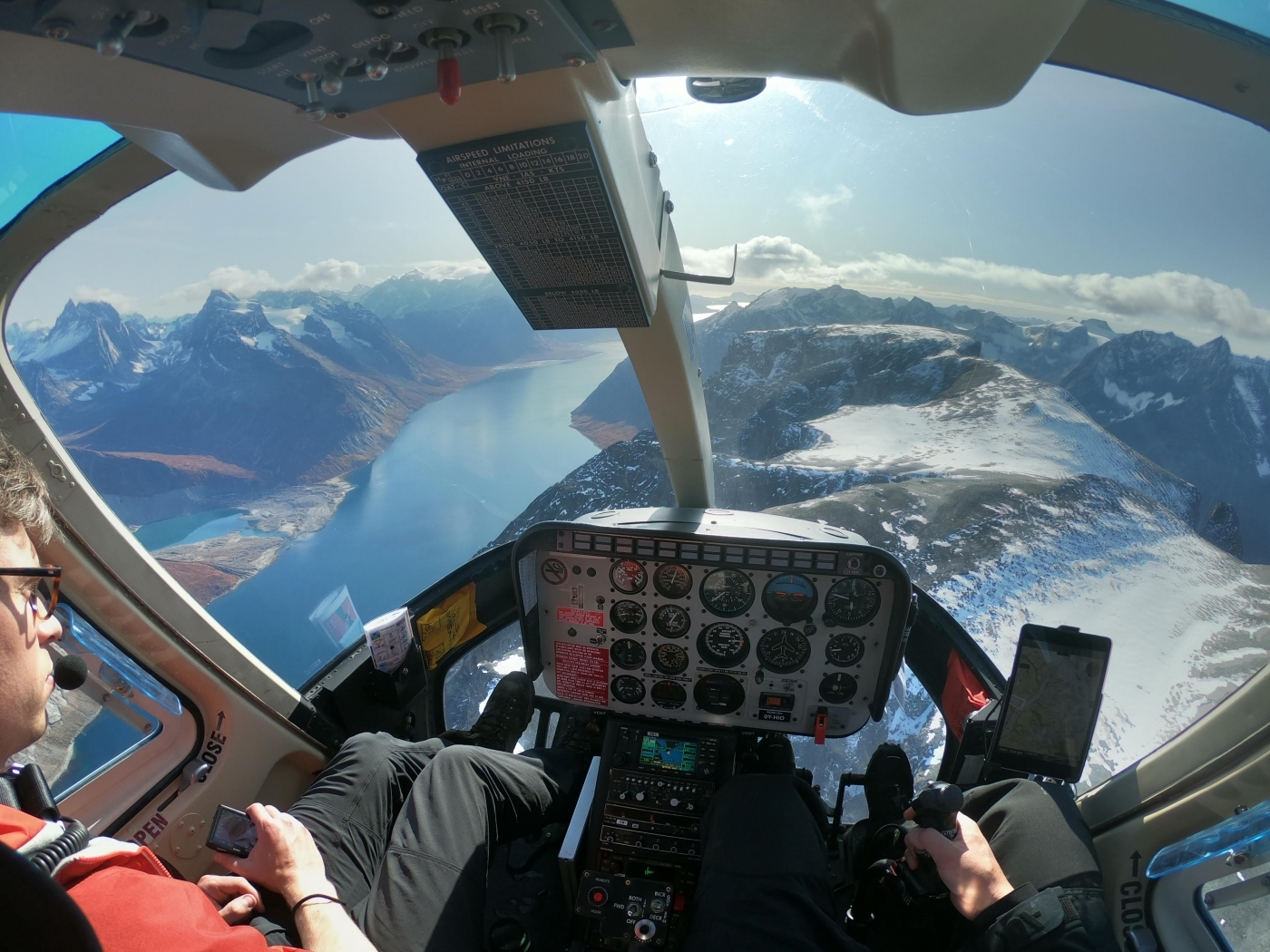 Sermeq Helicopters cockpit view of a fjord in South Greenland. Photo by Pilu Nielsen, Visit Greenland.
