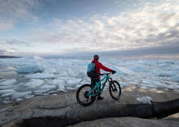 Chris Winter enjoying one of the most spectacular views you can get to by mountain bike. Ilulissat Icefjord, Ilulissat, North Greenland.Photo by Ben Haggar - Visit Greenland