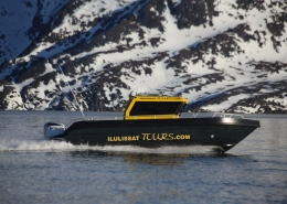 Ilulissattours boat sailing in Winter. Photo by Ilulissat Tours