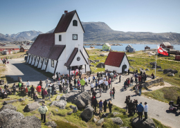 A large crowd of people gathered at the church in Nanortalik in South Greenland. Photo by Mads Pihl - Visit Greenland