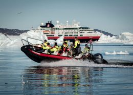 An ice cruise in front of MS Fram in Greenland. By Mads Pihl