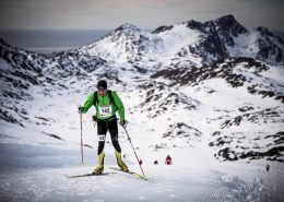 A skier climbing one of the many hills of the Arctic Circle Race. Photo by Mads Pihl, Visit Greenland