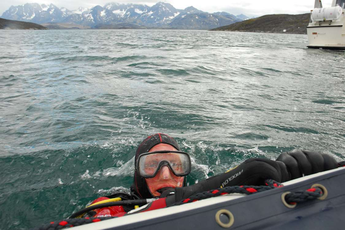 Scuba diver in the water near Sisimiut. Photo by Sirius Greenland