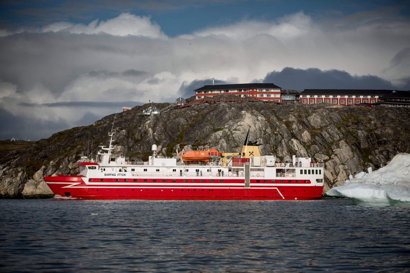 Sarfaq Ittuk passing underneath Hotel Arctic near Ilulissat in Greenland