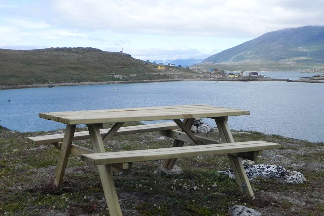 Bench with view of Kapisillit and Nuuk Fjord, Capital Region. Photo by Asimut Tours and Camp