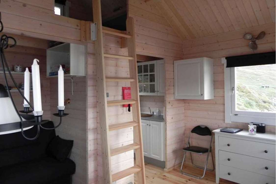 Inside view of hut in Kapisillit. Photo by Asimut Tours and Camp