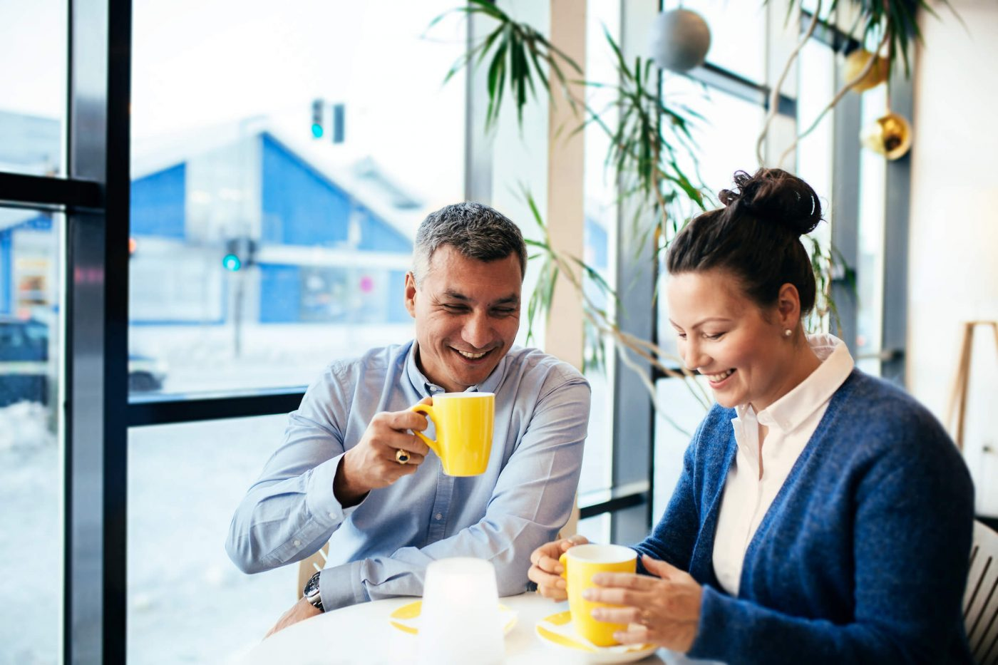 Couple enjoying coffee in Hotel Hans Egedes lobby in Nuuk, Greenland. By Rebecca Gustafsson