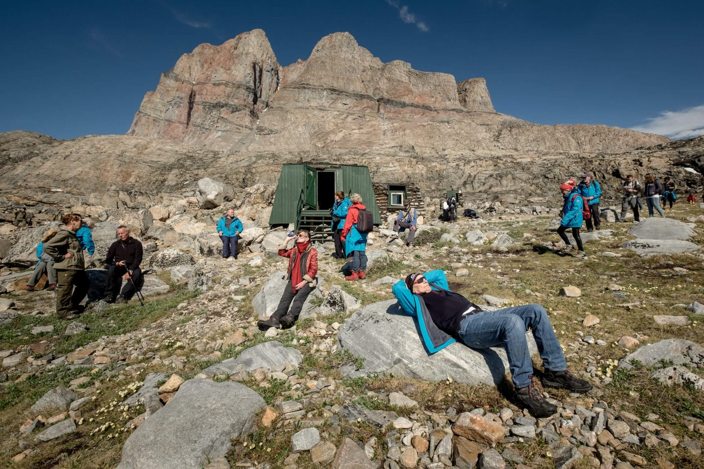 Cruise guests from MS Fram relaxing outside the Santa Claus cabin in Uummannaq in Greenland. By Mads Pihl