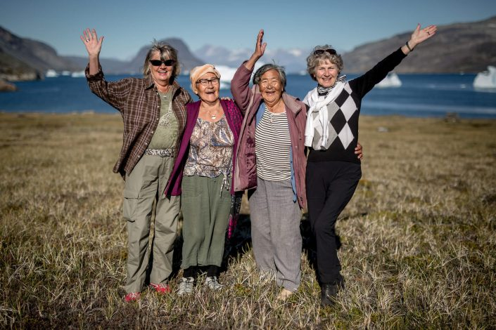 Four women waving hello in Narsaq in South Greenland. Photo by Mads Pihl