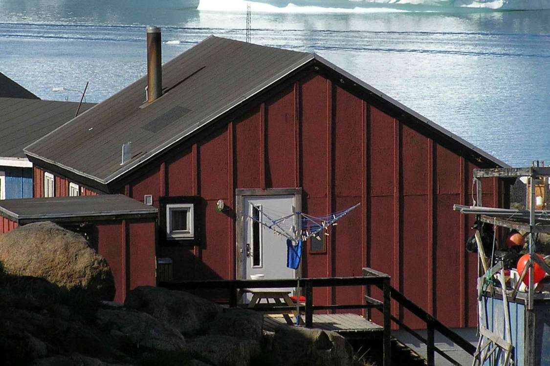 Gina's Guesthouse from the back with view over the water. Photo by John Kislov