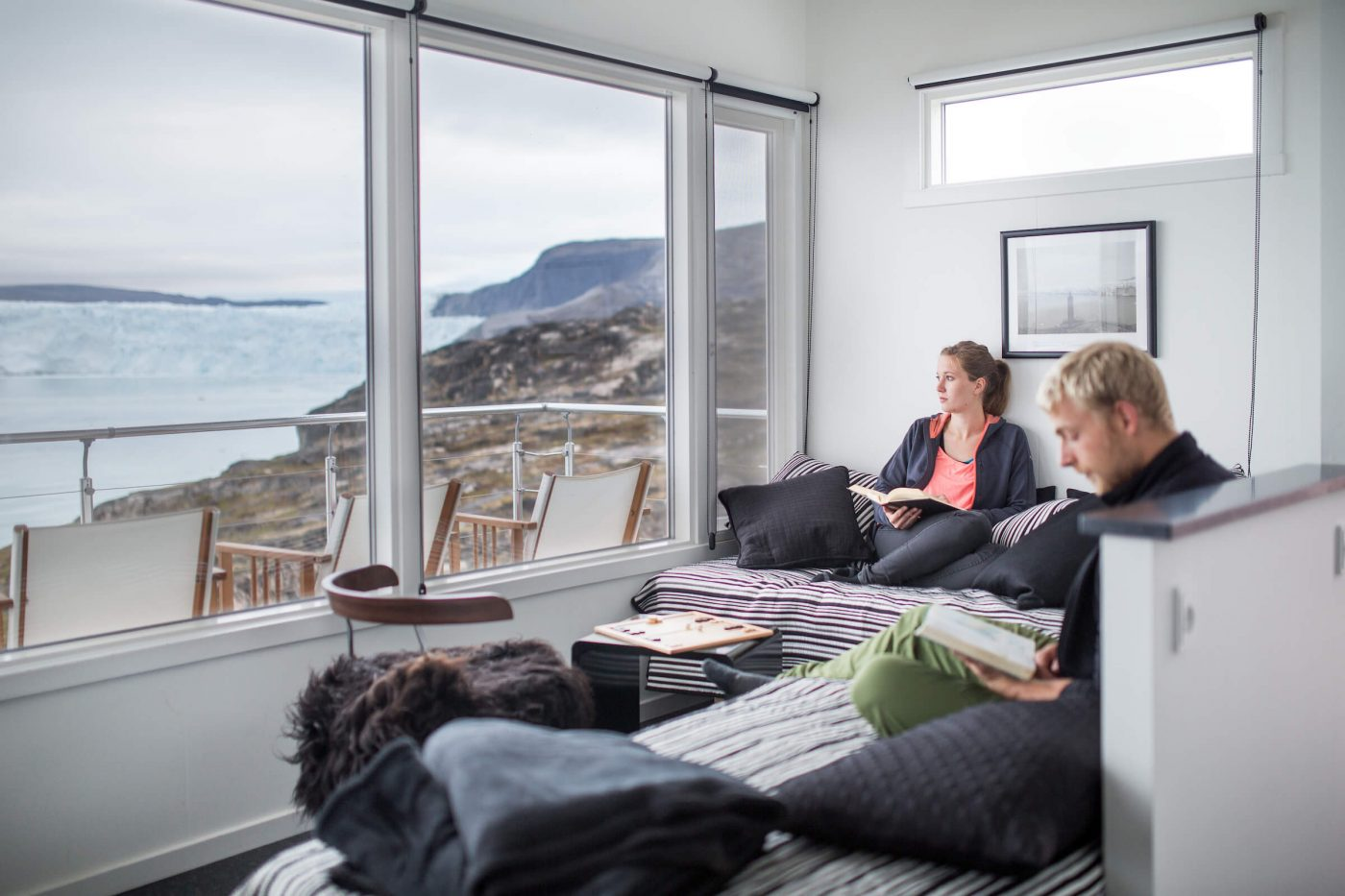 Guests enjoying a quiet moment in one of the Eqi Glacier Lodge comfort huts in Greenland. Photo by Mads Pihl, Visit Greenland