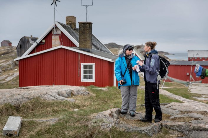 A tour guide and a guest in the abandoned settlement Assaqutaq near Sisimiut in Greenland. Photo by Mads Pihl, Visit Greenland