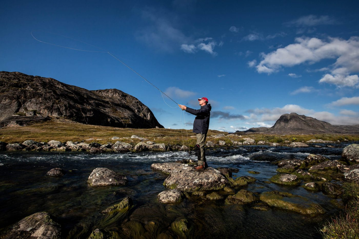 Fly fishing on the lower Erfalik river in Greenland. Photo by Mads Pihl