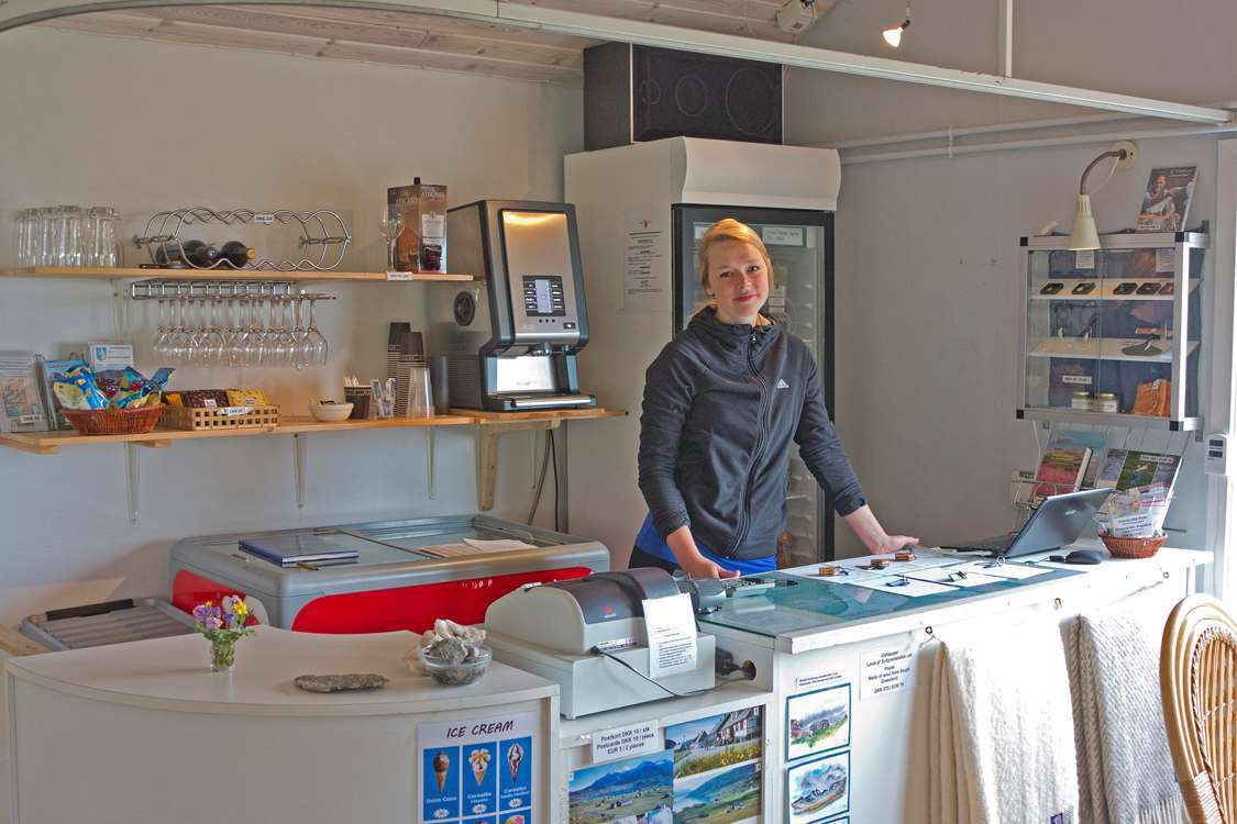 Igaliku cafe reception in South Greenland with food, drinks and souvenirs. Photo by Igaliku Café - Visit Greenland