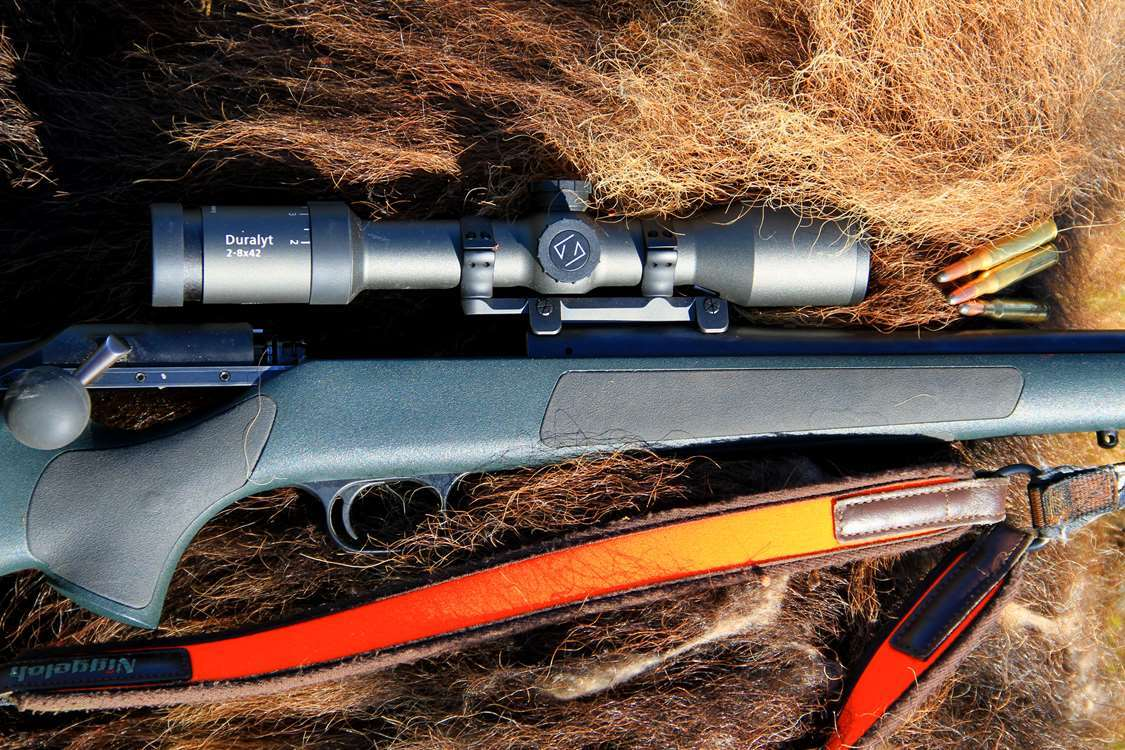 Hunting rifle on musk ox fur. Photo by Major Hunting