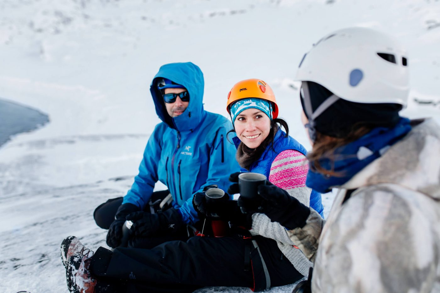 Mountain guide Marc Carreras taking a break with tourists on winter hike in Nuuk in Greenland. By Rebecca Gustafsson