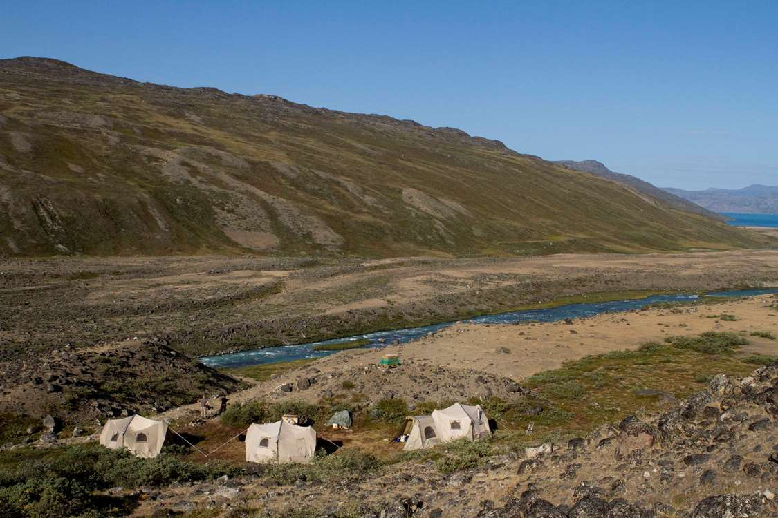 Hunting camp alongside river in Summer close to Kangerlussuaq, Greenland. Photo by North Safari Outfitters