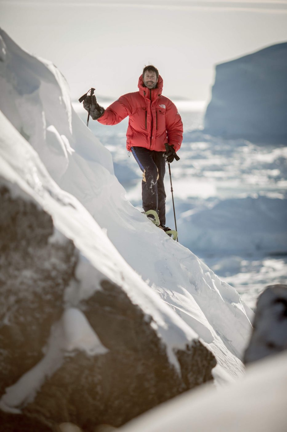 PGI Greenland guide and owner Marc Carreras snowshoeing at the Ilulissat ice fjord in Greenland. By Mads Pihl