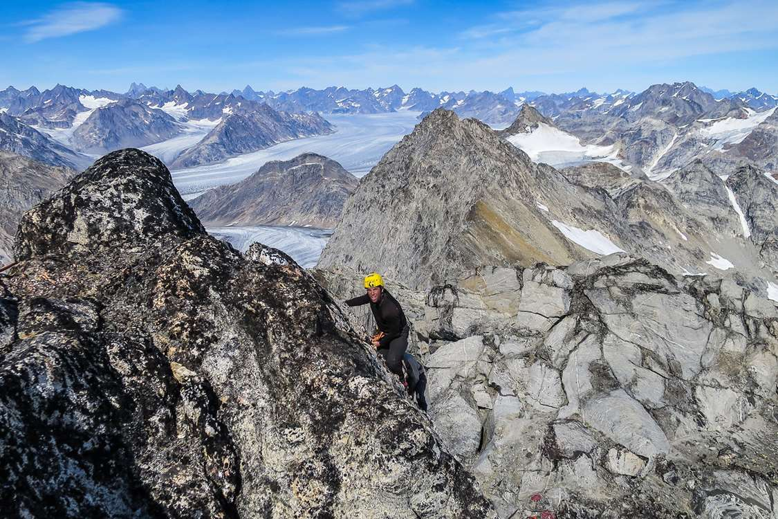 Climbing mountain in East Greenland on a sunny day. Photo by Pirhuk - Greenland Expedition Specialists