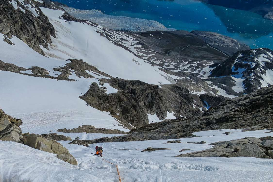 Climbing a steep mountain in East Greenland in Summer. Photo by Pirhuk - Greenland Expedition Specialists