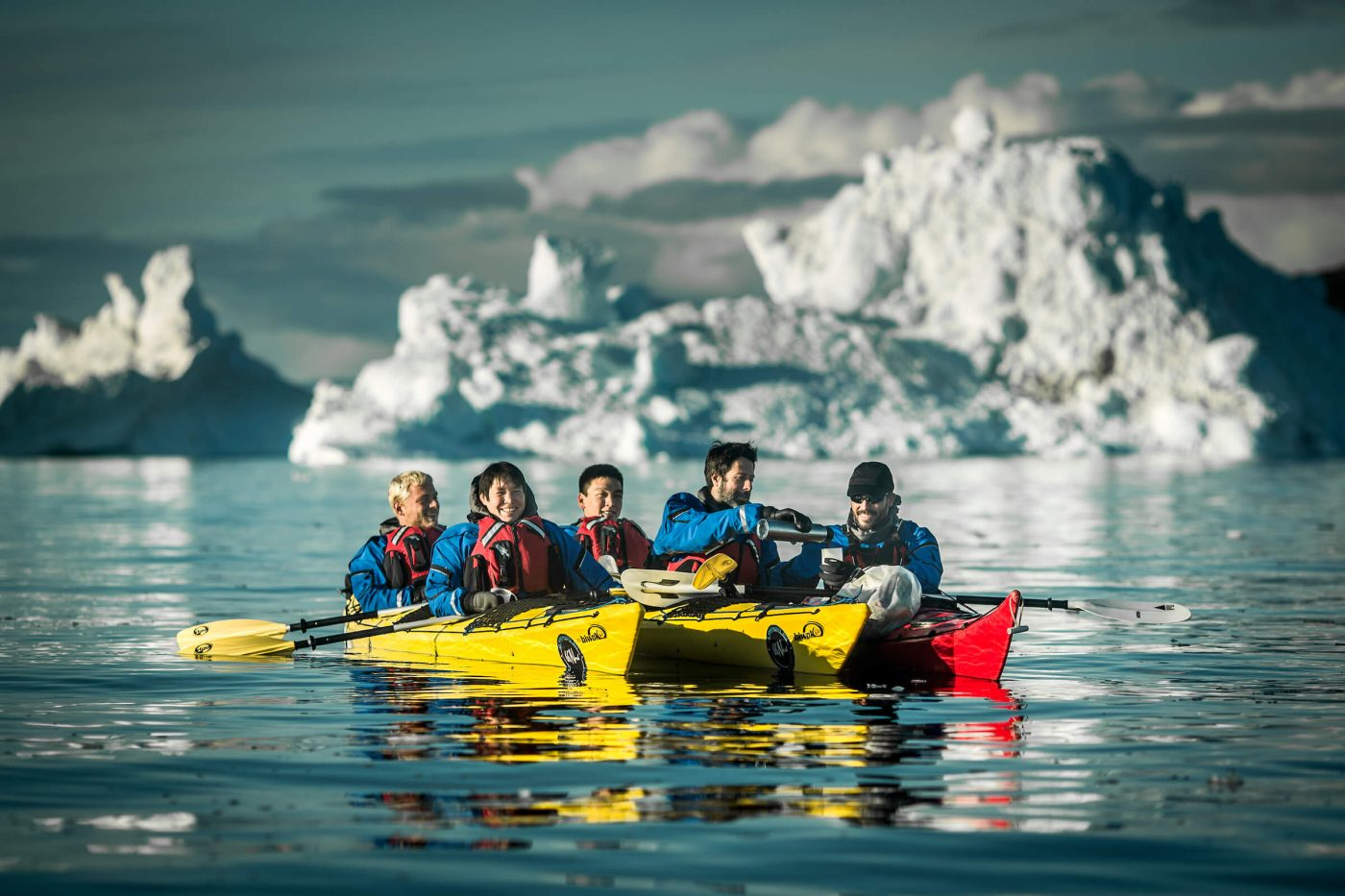 Pouring coffee on a kayaking trip among icebergs in the Disko Bay in Greenland. By Mads Pihl