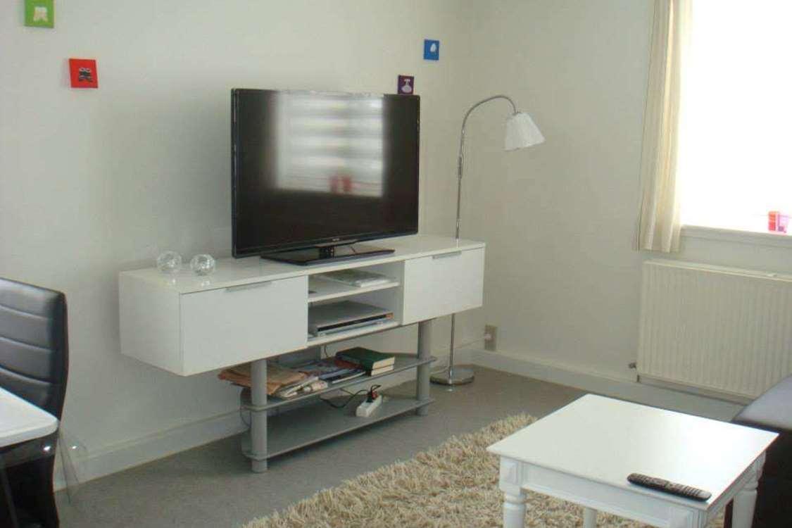 Living room with TV. Photo by Qaanaaq Accommodation