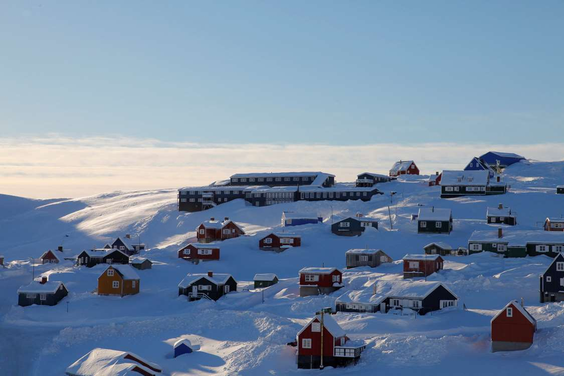City view of Tasiilaq with Hotel Angmagssalik at the top of a hill in winter. Photo by Hotel Angmagssalik