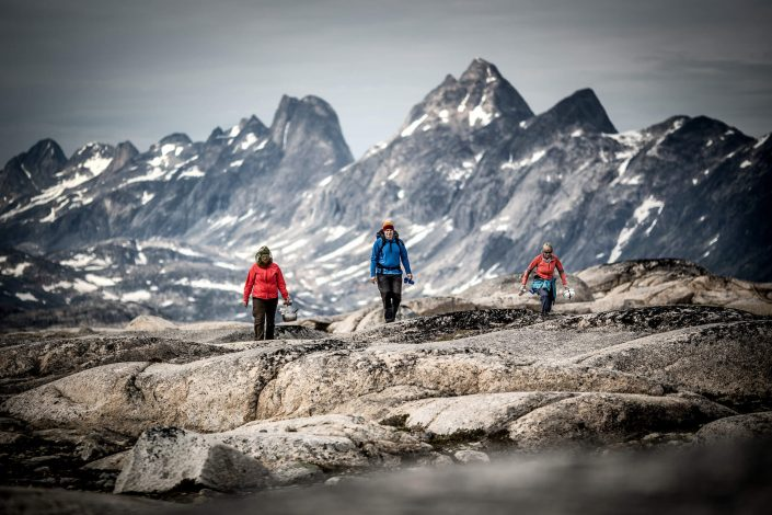 Three hikers in the mountains near Qernertivartivit not far from Kulusuk in East Greenland. Photo by Mads Pihl - Visit Greenland