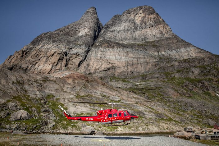 An Air Greenland Bell 212 passenger helicopter taking off from Aappilattoq in South Greenland. Photo by Mads Pihl.