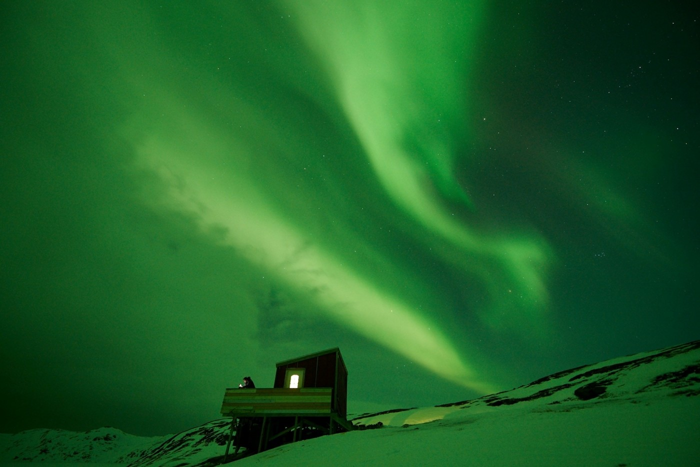 Cabin in Northern Lights. Photo by Nuuk Adventure - Visit Greenland