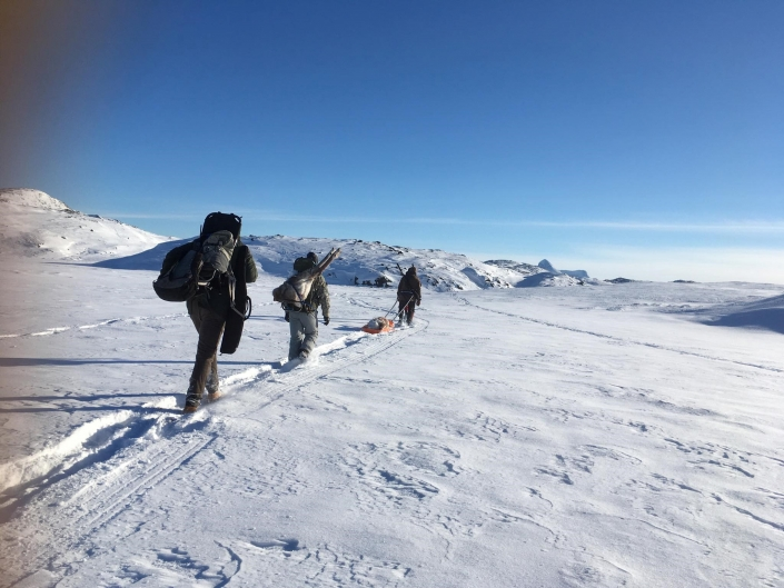 Hunting by the lake in Winter. Photo by Nuuk Adventure - Visit Greenland